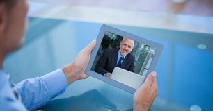 Cropped image of businessman having video call with colleague on tablet PC Stock Images
