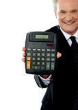 Cropped image of a businessman showing calculator Stock Image