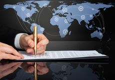 Cropped image of businessman signing contract Stock Image