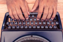 Cropped image of businessman typing on typewriter Stock Photos