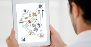 Cropped image of businessman using digital tablet with various icons on device screen Stock Image