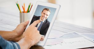 Cropped image of businessman video conferencing with colleague on tablet PC Royalty Free Stock Photos