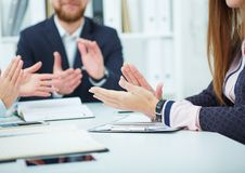 Cropped image of businesspeople clapping. Partners made deal, sealed with handclasp. Cropped image of young business people clapping Royalty Free Stock Images