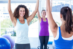 Cropped image of cheerful and fit women with arms raised Stock Photography