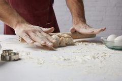 Chef rolling dough with rolling pin stock photography