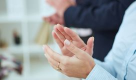 Cropped image of businesspeople clapping. Partners made deal, sealed with handclasp. Cropped image of clapping hands of business people Royalty Free Stock Image