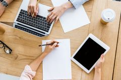 cropped image of colleagues working on startup project in office with tablet royalty free stock photo