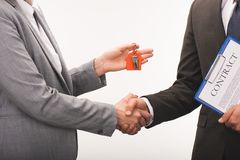 Cropped image of costumer and estate agent shaking hands. Isolated on white royalty free stock photography