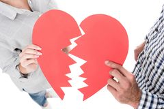 cropped image of couple holding two pieces of paper heart royalty free stock photography