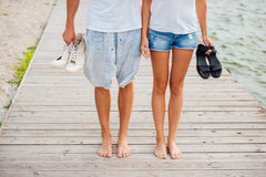 Cropped image of couple walking on the beach holding hands Royalty Free Stock Photos