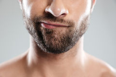 Cropped image of a doubtful bearded mans face Stock Photos