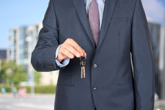 Cropped image of estate agent giving house keys outside Royalty Free Stock Photos
