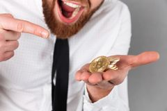 Cropped image of an excited businessman pointing finger Stock Photo