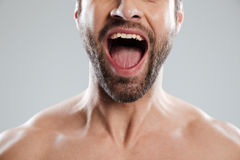 Cropped image of excited mans half face with naked shoulders Royalty Free Stock Images