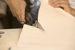 Cropped image of fashion designer cutting cloth Stock Photography