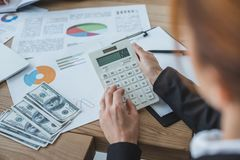 Cropped image of financier using calculator at work. In office royalty free stock photos