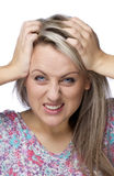 Cropped image of frustrated and angry woman. Is pulling her hair over white background Stock Photography