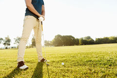 Cropped image of a golfer getting ready Royalty Free Stock Images