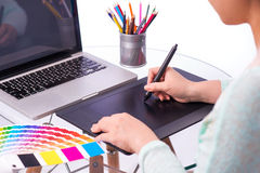 Cropped image of a graphic designer using graphic tablet. In her work on the foreground. A concept of digital working. Modern workplace office stock images