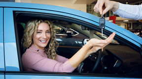 Cropped image of hand giving keys to customer Royalty Free Stock Photography