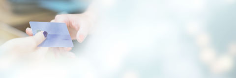 Cropped image of hand handing over credit card Royalty Free Stock Images
