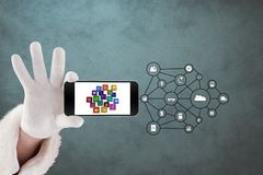 Cropped image of hand with smart phone and IOT symbols Stock Photo