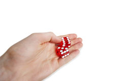 Cropped image of hands holding gambling cubes over white background Royalty Free Stock Photo