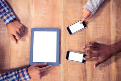 Cropped image of hands using mobile phone and tablet PC Royalty Free Stock Photo