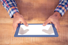 Cropped image of hands using tablet PC Stock Image