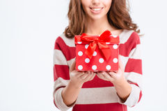 Cropped image of a happy woman holding gift box Royalty Free Stock Images