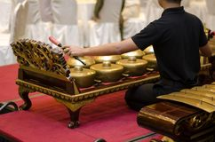 Cropped image high school boy performing traditional malay music stock image