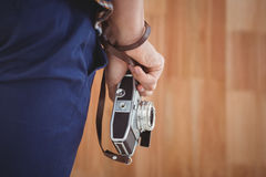 Cropped image of hipster holding camera Royalty Free Stock Photo