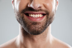 Cropped image of a laughing mans face with naked shoulders Royalty Free Stock Photography