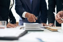 I found evidence here. Cropped image of lawyer showing evidence he found in papers to coworker royalty free stock photography