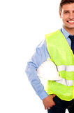 Cropped image of a male builder. Holding safety helmet beside his waist Stock Photos