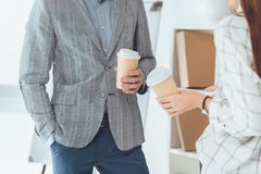 cropped image of male and female colleagues having coffee break stock photos
