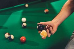 cropped image of male hand with billiard balls beside stock photography