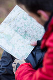 Cropped image of male hiker reading map Stock Photo