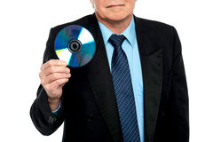 Cropped image of a male showing compact disk Royalty Free Stock Photo