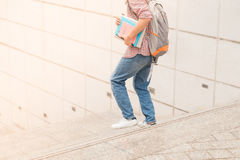 Cropped image of male student running with book in hands Stock Photography