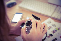 Cropped image of man adjusting camera lens Royalty Free Stock Images
