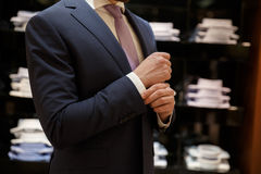 Cropped image of Man buttons up his shirt Stock Image
