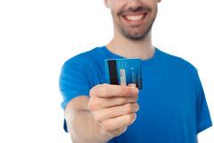 Cropped image of a man displaying his cash card Stock Photography