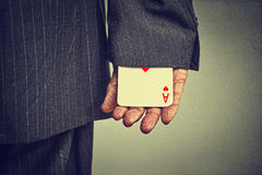 Cropped image man hand pulling out a hidden ace from the sleeve Royalty Free Stock Photo