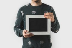 cropped image of man holding empty black board stock photography