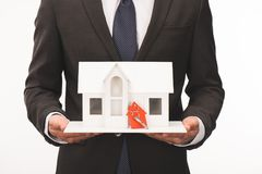 cropped image of man holding maquette of house with key stock photography