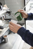 Cropped image of man pouring milk in cup at mobile coffee shop Stock Photography