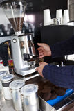 Cropped image of man preparing coffee at mobile coffee shop Royalty Free Stock Photo