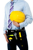Cropped image of a man with safety helmet Stock Photos