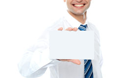 Cropped image of man showing business card Stock Photo